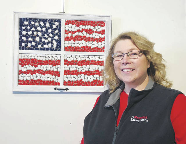 Marsha Bumgardner's mosaic art is dedicated in honor of all who have served to defend the Unites States of America.