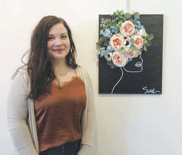 This artwork by Sarah Harris was inspired by her love for dark hues and bright florals.