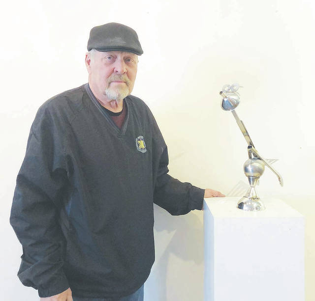 "Pat Thackery's artwork ""Bird of Paradiso"" is a sculpture made of cooking utensils from Cafe Paradiso's kitchen."