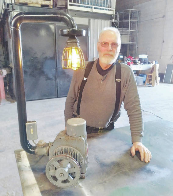 Ted Wallen's artwork uses old discarded metal and equipment to repurpose into a usable fun conversation piece.