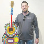 Vote for this guitar art if it makes you smile