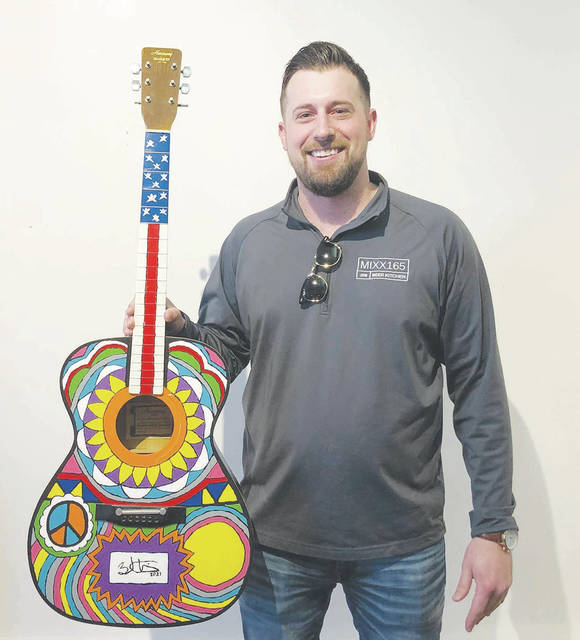 Brad Winner enjoys guitars, cooking and gardening. His art, an up-cycled guitar, is meant to elicit smiles.