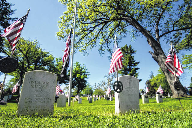 Soldiers' Mound at Oak Dale Cemetery is shown in this file photo during a 2020 Memorial Day observance. Such events were curtailed or participants were socially-distanced due to the onset of the COVID-19 pandemic last year.