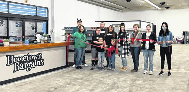 The Champaign County Chamber of Commerce held a ribbon cutting Saturday, May 1 for Hometown Bargains located at 1637 E. U.S. Route 36, Urbana. Hometown Bargains is a wholesale pallets and liquidation retail store. Hours of operation are Mon. & Tues. 10 a.m.- 6 p.m., Wed. 10 a.m. -5 p.m. (online sales), Thur. & Fri. closed, Sat. & Sun. 10 a.m.- 5 p.m. Pictured left to right: Rodney Wolfe, Michelle Smith, Maverick Geer, Miles Geer, Justin Geer (owner), Heidi Geer (owner), Marlee Geer, Hannah Smith, Marcia Bailey, Cierra Marchal, and Rachel Casey.