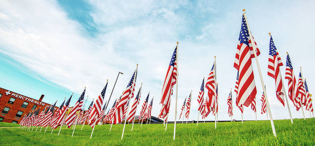 From May 22-24, volunteers and organizers will transform the grassy lawn at Mercy Health- Urbana Hospital into a tribute of red, white and blue.