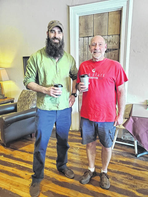 Pictured from left are Adam Sorensen, director of treatment and recovery at the MHDAS Board of Logan and Champaign counties and Merv Miller, owner of Simple Comforts Coffee House.