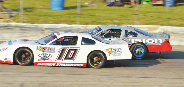 Former late model track champion Bud Perry of Eden, Ohio, battles with Kenny George Jr. during the 2020 season. Perry is among the early entries for Saturday's 75-lap late model feature at Shady Bowl.