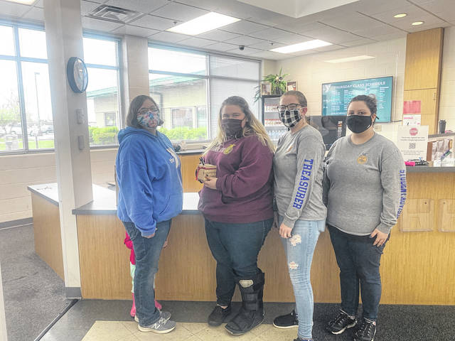 Pictured left to right are YMCA Staff member Tabitha Stambaugh, Urbana FFA Students: McKayla Mills, Faith Denkewalter and Marah Kerns.