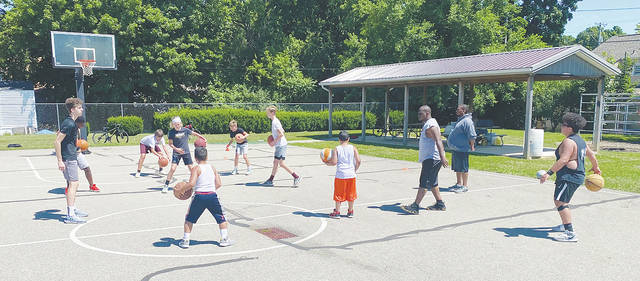 """Local kids work on their basketball skills at the Market Street courts in Barbara Howell Park in Urbana this week. Any youth interested in working on their individual skills, they or their parents may reach out to Matt Vactor Sr. or Andrew Vactor Sr. If anyone wants to donate basketballs or water coolers, they are more than welcome. The Vactors say they are striving to foster a summer environment to """"support our youth and their visions and goals."""""""