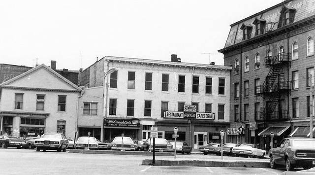 This is a circa 1974 photo of the southwest corner of Monument Square showing Ewing's Restaurant and Cafeteria.