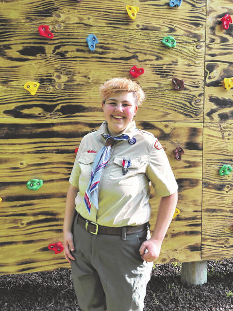 Eagle Scout Samantha Meyer stands beside her Eagle project, a climbing wall for children participating in Champaign Family YMCA classes.