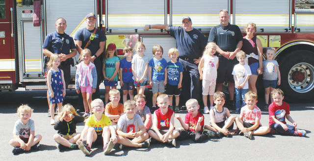 Safety Town participants pose with members of the Urbana Fire Division.