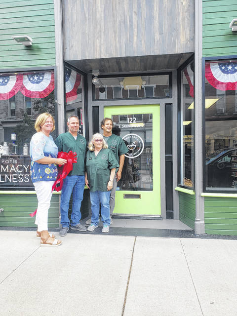 On Friday, July 2, the Champaign Chamber of Commerce held a ribbon-cutting for the St. Paris Pharmacy & Wellness located at 122 S. Springfield St. in St. Paris. The pharmacy is under the new ownership of Gaye Carafa and Craig Carafa. The storefront was recently painted and has new signage. Pictured left to right: Gaye Carafa, owner, Jeff Griffin, technician, Susan Millington, cashier, Craig Carafa, owner.