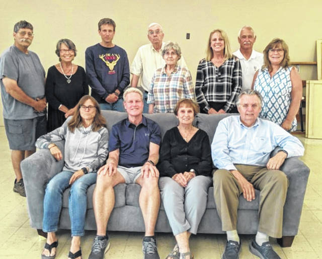 The Board of Directors for Habitat for Humanity in Champaign County, Ohio (HFHCCO) have announced their ReStore at 1007 N. Main in Urbana will have a Grand Opening on Aug. 5, 2021. The previous store was located at 955 N. Main. The current board is comprised of the following members: Seated, left tto right – Michele Johnson, Secretary; Brian Newman, ED; Ginny Stanley, VP and Mentor Chair; Rev. Ray Branstiter, President. Standing, left to right – Frank Segreti, Co-build Chair/Safety; Marcia Ward, Build/Food crews and PR; Rob Johnson, Grant writer; Dan and Marge Baker – Selection Chair/Asst Treasurer; Beth Ropp, Loan official; Greg Ward, Co-build Chair; Judy Geers, Treasurer.