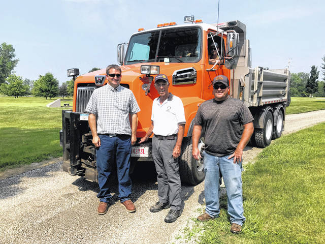 Pictured are the men who helped with the project (from left): Danny Boggs, Mike Pullins and John Crowder. Boggs is the road superintendent for the Champaign County Department of Engineers and John Crowder is the department's crew leader.