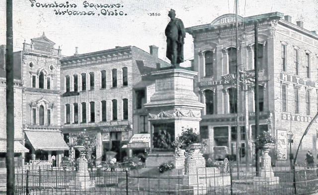 """Photo #1 is a postcard photo of the store in 1913. In the foreground of this photo is the """"Man on the Monument"""" whose 150th anniversary will be celebrated this year."""