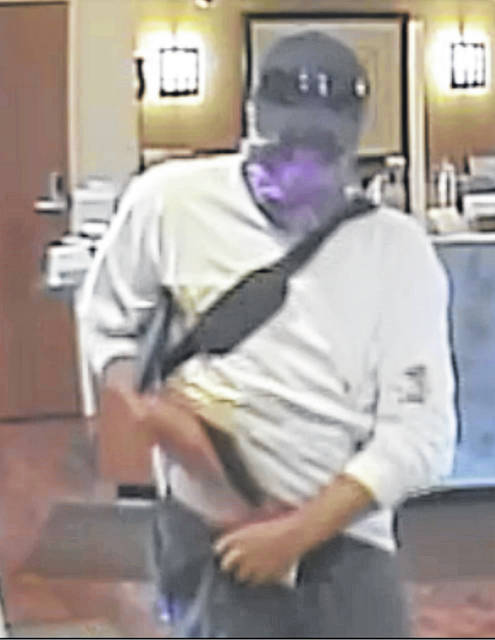 A still image from a video security camera shows the bank robber on Tuesday in West Liberty.