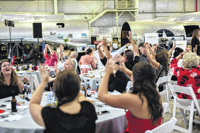 """The Champaign County Chamber of Commerce & Visitors Bureau invites all community members to celebrate """"Together Again"""" at the Chamber's Annual Dinner and Meeting on Thursday, Oct. 28."""