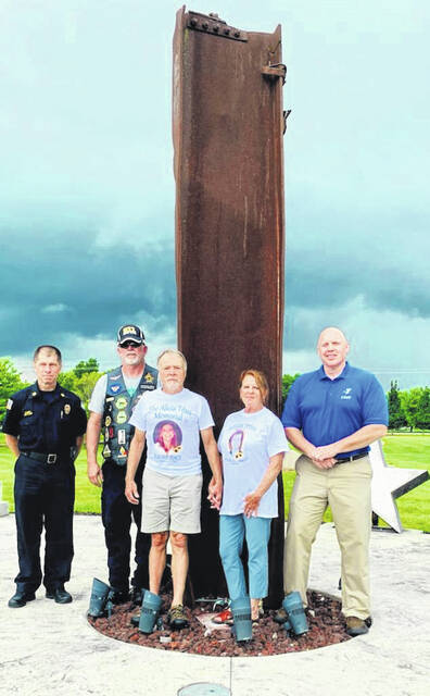 Pictured at Freedom Grove are Urbana Fire Chief Dean Ortlieb, Jamie Shaffner (co-organizer of the Patriots Day activities each year at Freedom Grove), John and Bev Titus and Rotarian Paul Waldsmith.