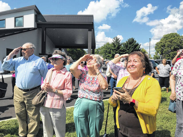 """A """"soft opening"""" ice cream social and flag raising was held for Senior Center members on Friday, September 17."""