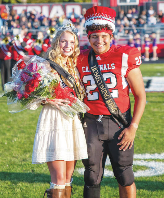 Afton Osterholt and Diego Hernandez were named Triad's homecoming queen and king prior to Friday night's game with visiting Mechanicsburg.