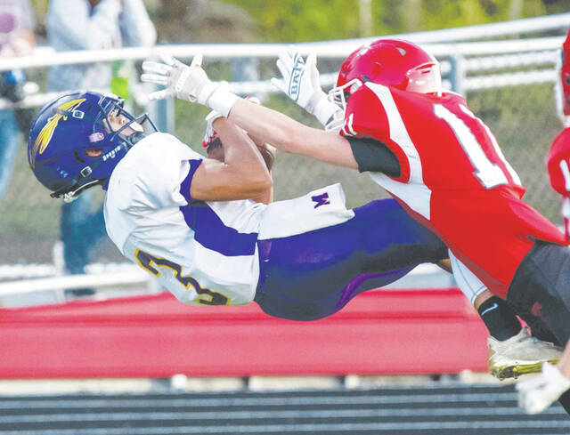 Mechanicsburg's Kailen Butler lays out in mid-air to make a reception against Triad Friday night.