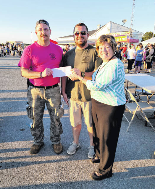 Hodge Hager (left) and Josh Clark (right) tied for first place in the Marco's Pizza Eating Contest held during the recent Balloon Fest. Both ate a medium pizza and swallowed their last bite at the same time! Sandy Gonzalez, event committee, presented the winners with a gift certificate of a free medium pizza each month for a year from the contest sponsors, Marco's pizza.