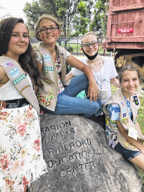 Shown left to right are Emily Hughes, Troop 30006, Ashley Hughes, Troop 30006, Leslie Holbrook, Troop 32046 and Kaylin Hedrick, Troop 2051. Unable to help due to illness was Hailey Grider.