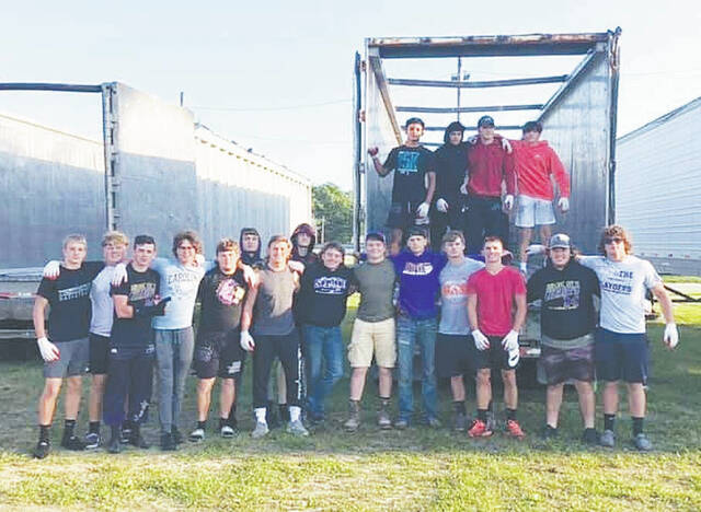 The Mechanicsburg High School football team assisted with the scrap tire recycling event on Sept. 11.