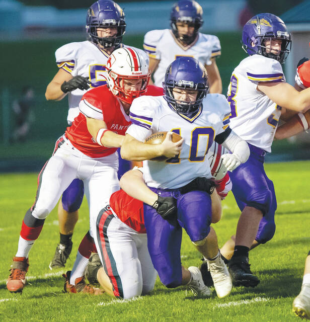 Mechanicsburg quarterback Aaron Conley (10) stretches for extra yardage during Friday night's game at Fairbanks.