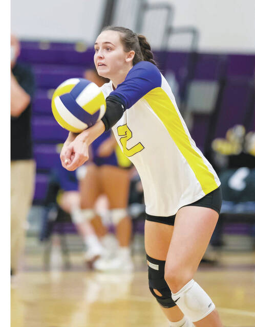 Mechanicsburg's Abby Lawhorn (pictured) returns a serve against visiting West Jefferson. Lawhorn recorded her 1,000th career dig in the match.