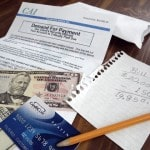 Study: Americans pay down debt, but still rack it up