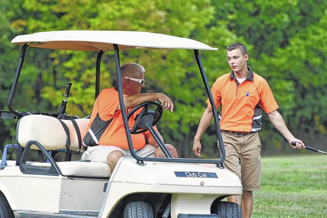 Galion men's golf coach Bryce Lehman chats with Mitch Dyer on the 12th hole at Sycamore Creek Golf Club as the Tigers hosted River Valley and Jonathan Alder. Photo by Don Tudor.