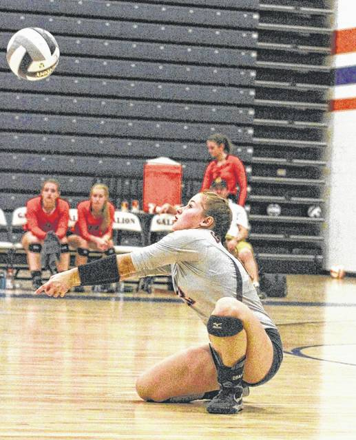 Galion's Nicole Thomas digs out a kill attempt during Tuesday's home action against the Ontario Lady Warriors.  The Lady Tigers defeated the visitors in five sets to gain sole possession of first place in the MOAC.