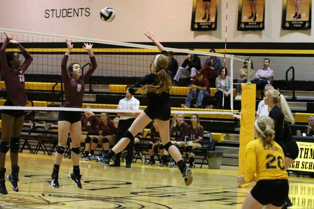 Northmor's Anna Donner throws down one of her 17 kills of the night on Tuesday against Columbus Academy. The Lady Knights won in straight sets to advance to the sectional championship game.