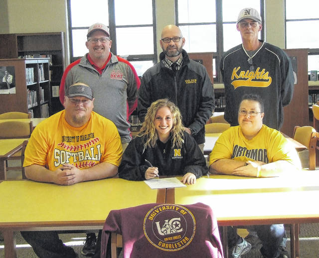 Northmor senior Cristianna Boggs signed her letter of intent to play softball for the University of Charleston on Wednesday. Parents Dave and Missy are in the front row with her, while in the back row are (l-r): travel ball coach Shayne Yeater, Northmor principal Benjamin Bethea and Northmor softball coach Russ Montgomery.
