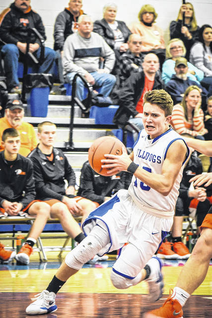 Shelley West Clark | Galion Inquirer Crestline's Max Anatra drives to the hoop during Friday night's MBC action against the visiting Lucas Cubs. Anatra led the Bulldogs in scoring with 14 points but it was the Cubs earning the 70-61 victory.