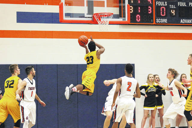 Erin Miller | Galion Inquirer Northmor's Meechie Johnson soars through the air for two of his 24 points on Tuesday against the Galion Tigers. The Golden Knights survived the Tigers to move to 13-0 on the season.