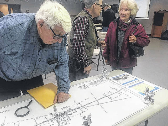 Ralph Hawk looks at the track lines of Morrow County's railroads prior to a program last Tuesday.