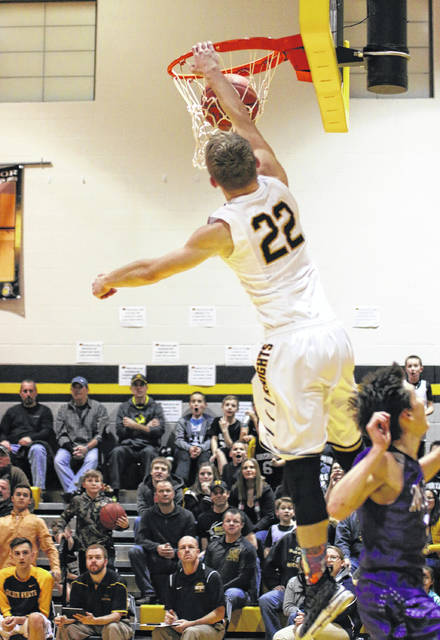 Erin Miller   Galion Inquirer Northmor's Brock Pletcher throws down a one-handed slam Friday evening in the Knights game against conference rival, the Mount Gilead Indians. The Golden Knights remain undefeated in the KMAC after defeating the Indians; 67-45.