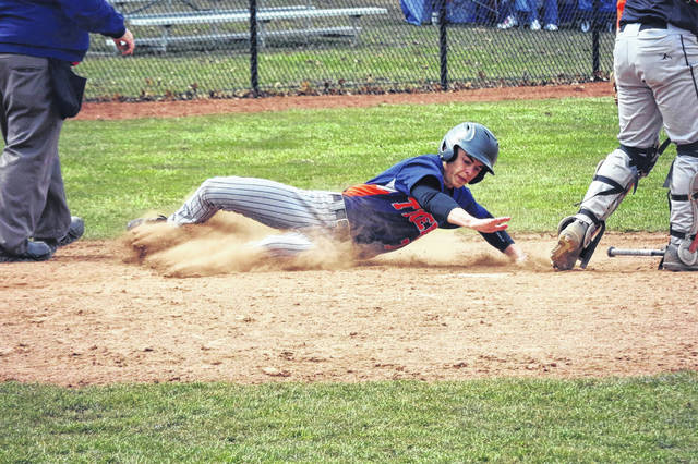 Erin Miller | Galion Inquirer The Galion Tigers had themselves an offensive explosion on Saturday during a non-conference doubleheader with the Seneca East Tigers. In the two games, Galion put up a total of 30 runs and Mitch Dyer, pictured sliding into home, scored two of them.