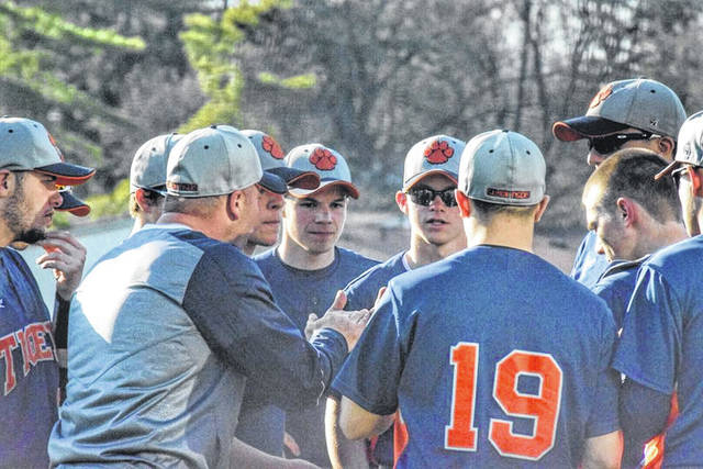 Photo courtesy of Angie Gibson Utz Galion head baseball coach Phil Jackson leads a meeting on the mound during MOAC action against the visiting Pleasant Spartans on Friday. The Tigers defeated the Spartans, as well as Willard and Colonel Crawford over the weekend to improve to 11-6 overall on the season.