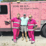 Helping people heal: Passing out hope, hugs from a bright pink firetruck
