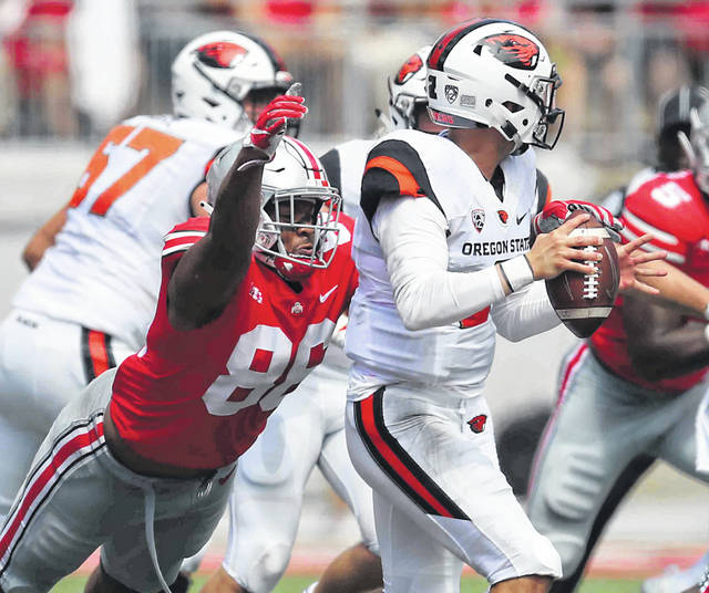Ohio State #88 Jeremy Ruckert gets the sack on Oregon State #2 Conor Blount in the first half at Ohio Stadium on the campus of The Ohio State University September 1st 2018 Photos by Don Speck