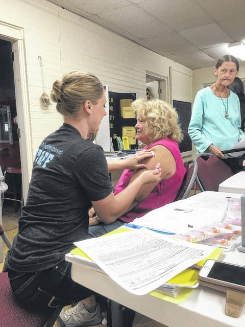 Nurse Emily Miller administers a flu shot to resident Sandra Rinehart at a walk in clinic held on Monday at the Galion Golden Age Center.  According to Miller, they had seen administered approximately fifty shots by midday Monday.  Rinehart said that getting her flu shot was a yearly occurrence for her as a part of regular health maintenance.