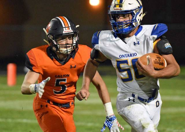 Don Tudor | Galion Inquirer The Galion Tigers' Steve Hoffman chases down Ontario back Noah Creed during week nine MOAC football action. In a cold and rainy contest, the Tigers emerged victorious; 45-21.
