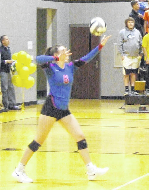 Highland's Makenna Belcher prepares to serve the ball in her team's straight-set win over Northmor Thursday.