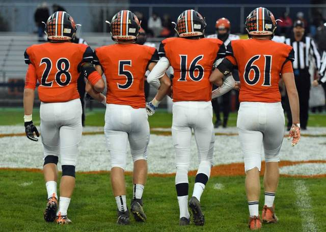 Don Tudor | Galion Inquirer Senior leaders (from left to right) Colbey Fox, Steve Hoffman, Elias Middleton and Noah Grochowalksi approach midfield for the pregame coin toss on Friday. In the dismal weather, Galion was defeated by the visiting North Union Wildcats; 49-35.
