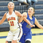 Lady Tigers edge 'Dogs in season opener
