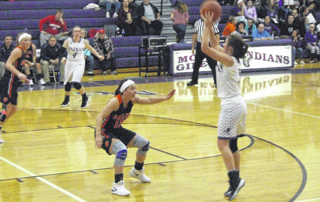 Mount Gilead's Holly Gompf puts up a long shot attempt against the defense of Galion's Gabby Kaple on Monday night. MG won the game by a 44-39 margin thanks to a big fourth quarter.